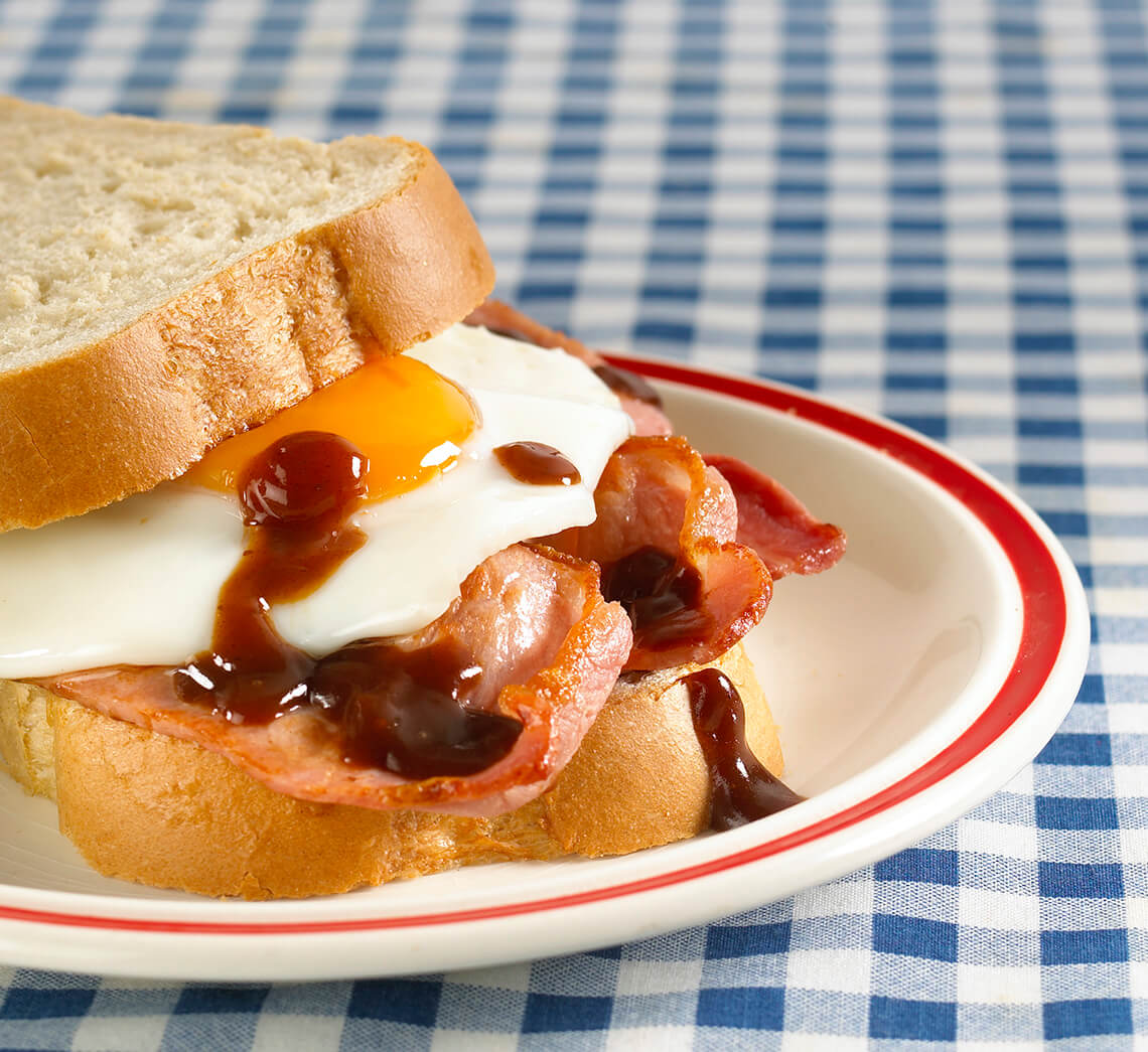 bacon an egg butty topped with brown sauce