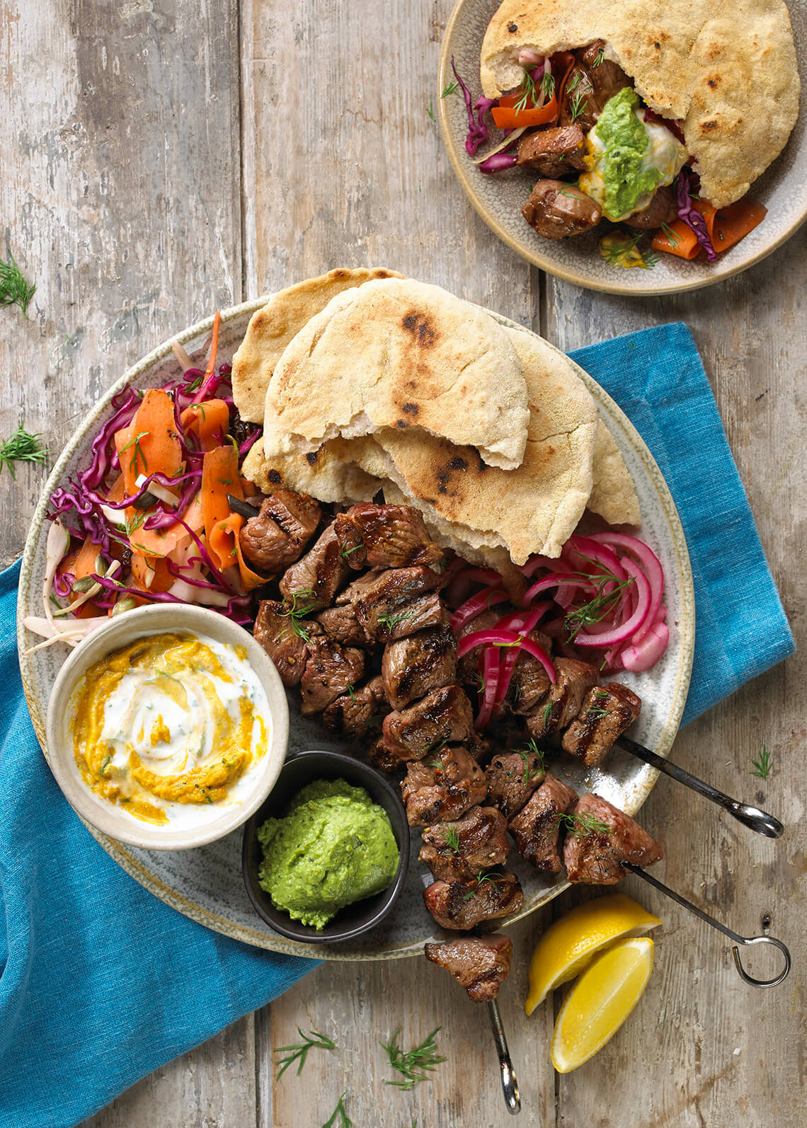 Lamb skewers with flatbreads.